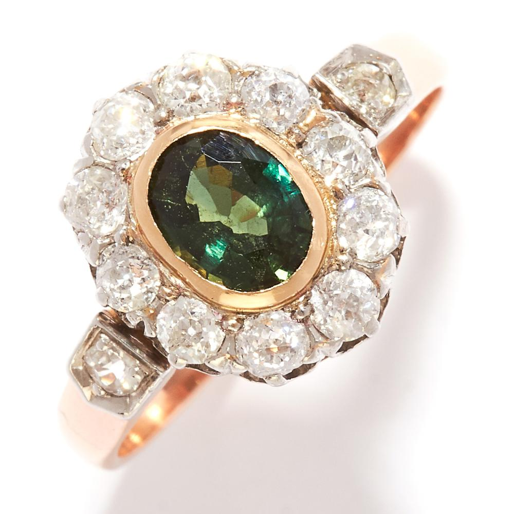 GREEN SAPPHIRE AND DIAMOND CLUSTER RING in yellow gold, set with an oval cut green sapphire in a cluster of old cut diamonds, unmarked, size N / 6, 3.69g.