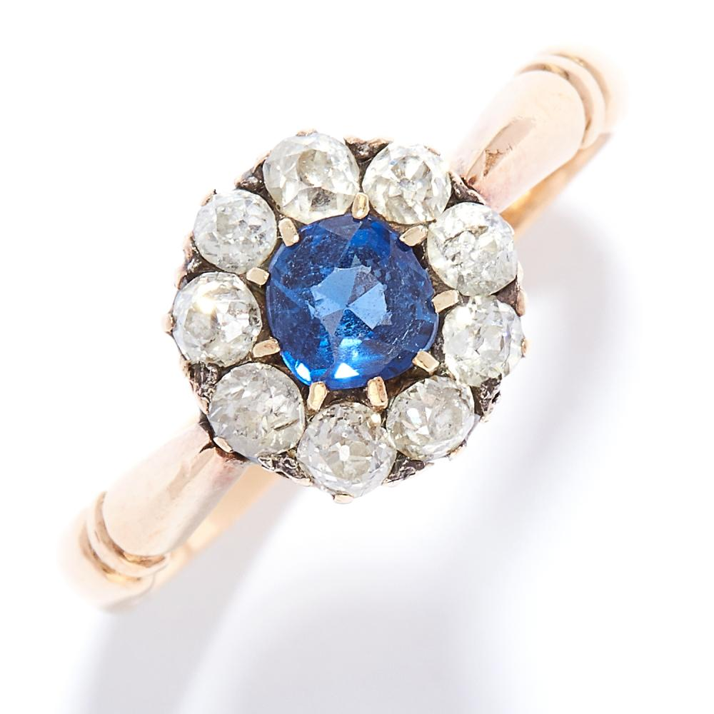 ANTIQUE SAPPHIRE AND DIAMOND CLUSTER RING, 1876 in 18ct yellow gold, set with a round cut sapphire encircled by old cut diamonds, full British hallmarks, size O / 7, 4.2g.