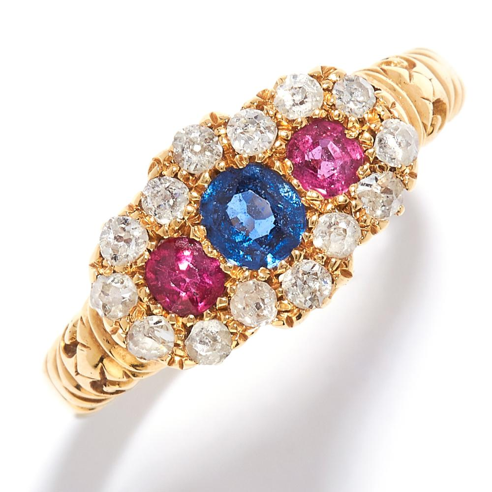 ANTIQUE SAPPHIRE, RUBY AND DIAMOND RING in 18ct yellow gold, set with a round cut sapphire between two round cut rubies, in a cluster of round cut diamonds, British hallmarks, size S / 9, 4.75g.