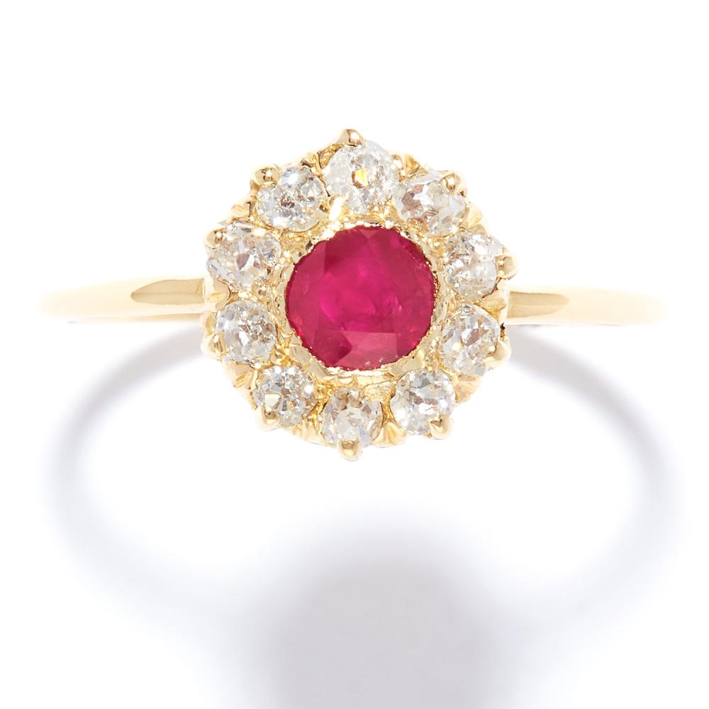 ANTIQUE RUBY AND DIAMOND CLUSTER RING in high carat yellow gold, set with a round cut ruby in a cluster of old cut diamonds, unmarked, size Q / 8, 2.04g.