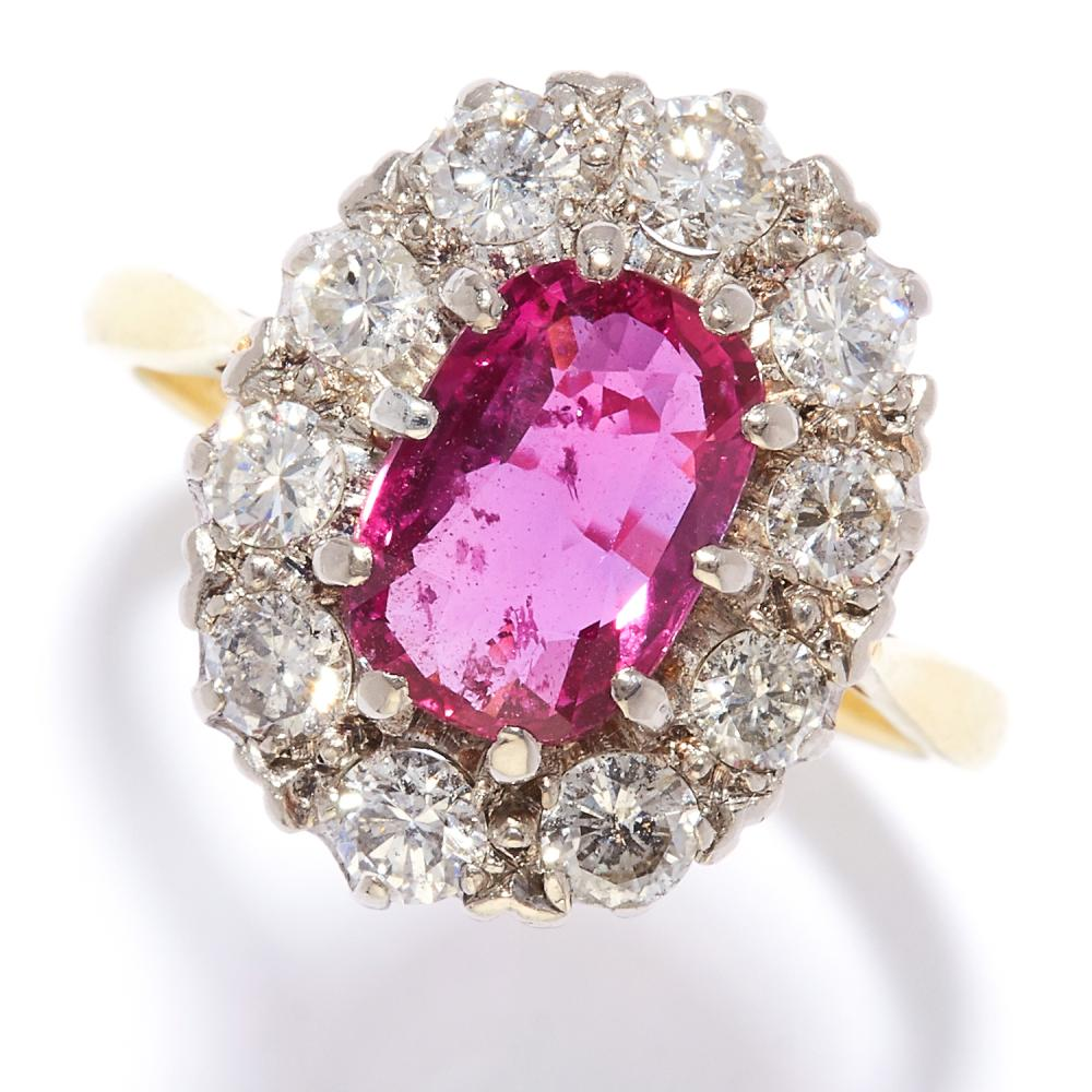 A 3.02 CARAT RUBY AND DIAMOND CLUSTER RING in 18ct yellow gold, designed as a 3.02 carat ruby set in a diamond surround, unmarked, size Q / 8, 6.3g. Accompanied by a gemological report stating no indications of heating.