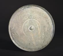 A CARVED BRONZE MIRROR  (Han Dynasty)