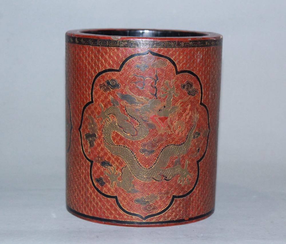 A RED-LACQUER 'DRAGON' WOOD BRUSHPOT.MARK OF QIANLONG