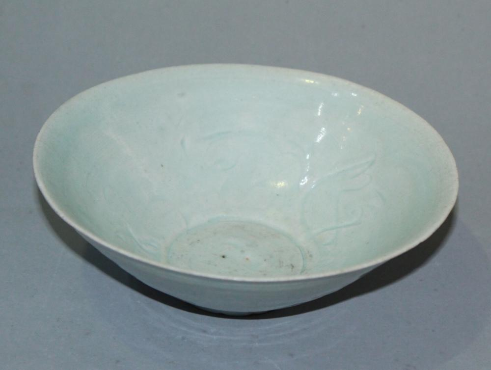 A CARVED CELADON-GLAZED BOWL.SONG PERIOD