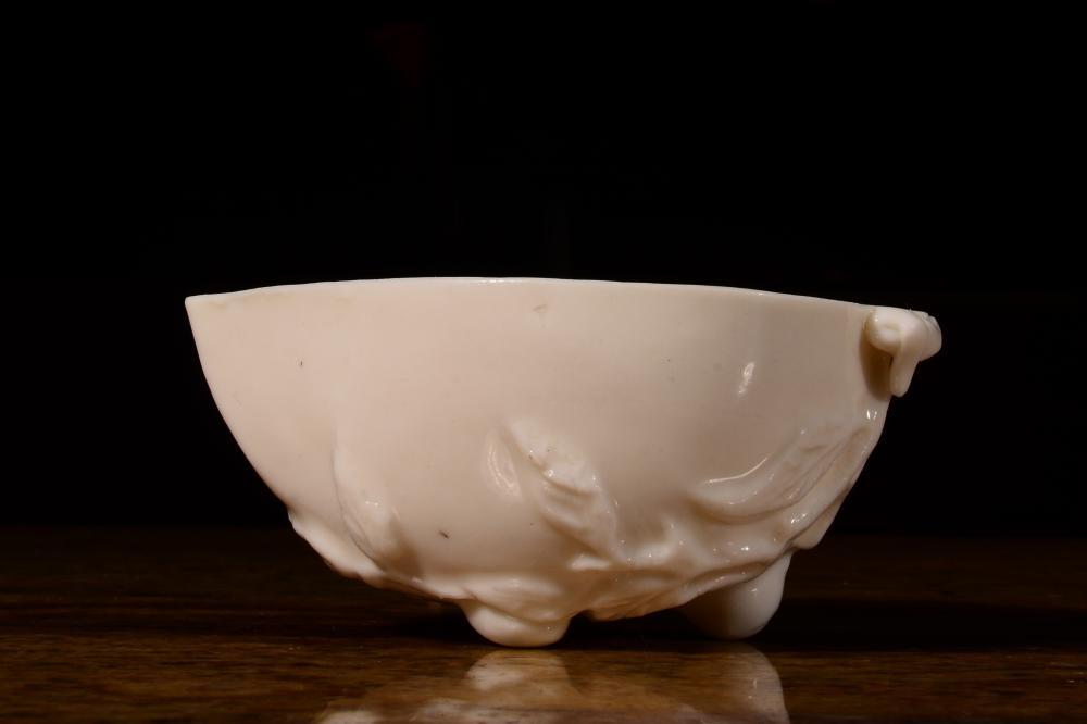 A WHITE-GLAZED 'PEACH' CUP.QIMG PERIOD
