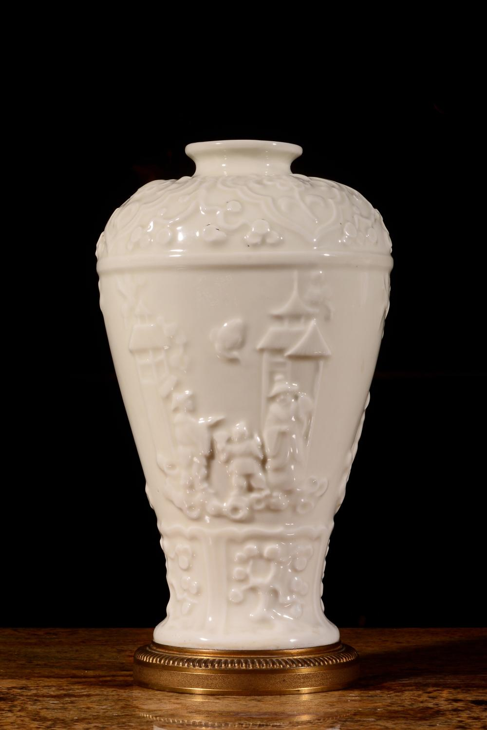 A CARVED WHITE-GLAZED MEIPING.QING PERIOD