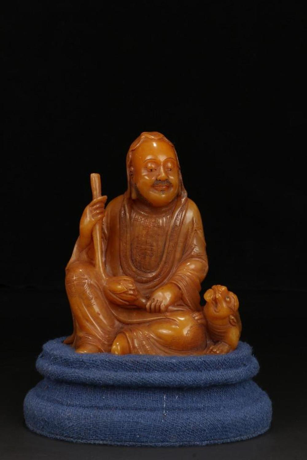 A SOAPSTONE FIGURE OF LUOHAN.QING PERIOD