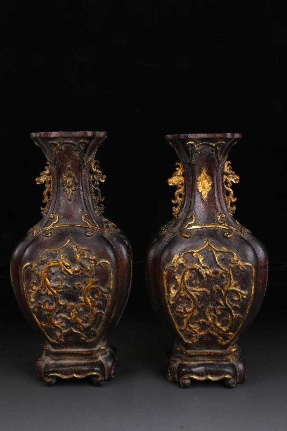 A PAIR OF AGALLOCH WOOD VASES.ANTIQUE