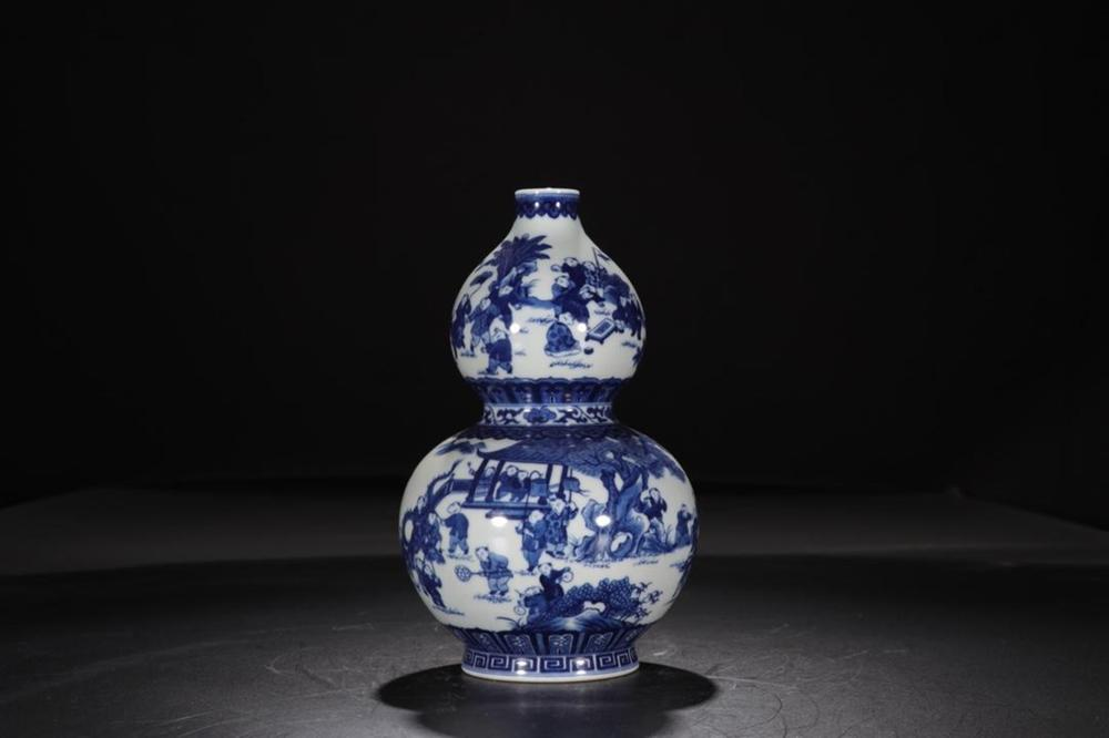 A BLUE AND WHITE 'BOY' DOUBLE-GOURD VASE.MARK OF QIANLONG