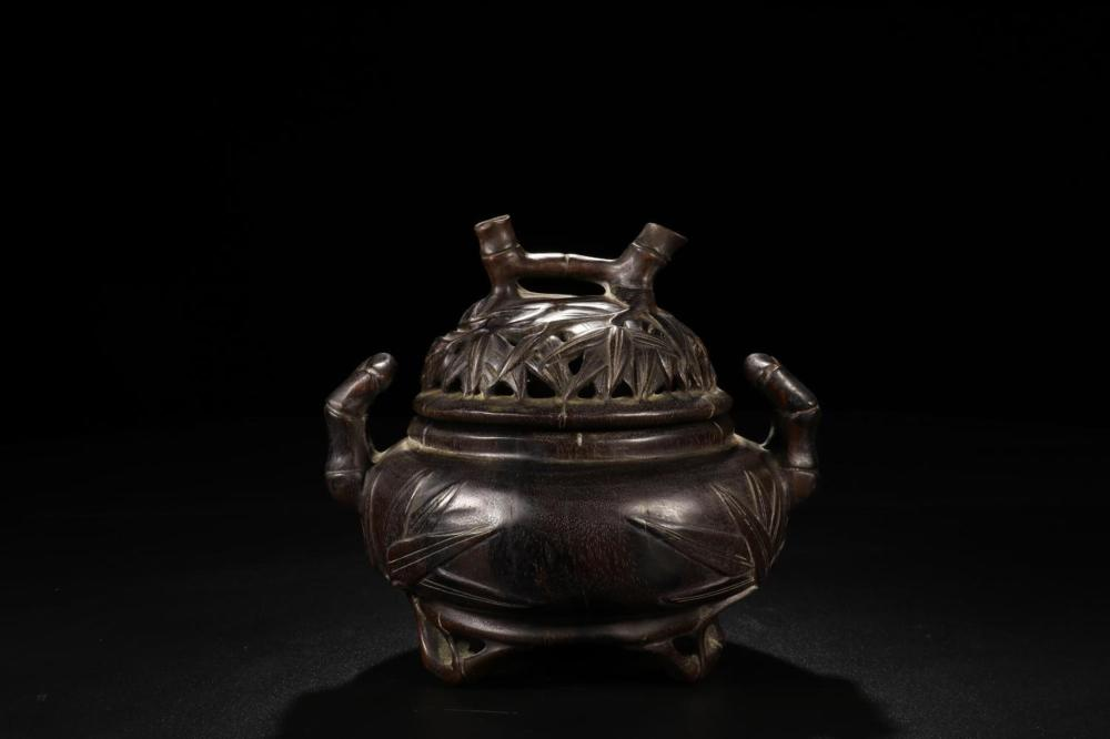 A CARVED ZITAN BURNER AND COVER.QING PERIOD