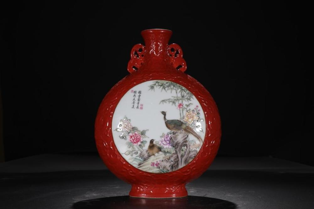 A CORAL-GROUND FAMILLE-ROSE MOONFLASK.MARK OF YONG ZHENG