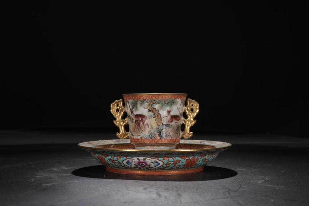 A PAINTED ENAMEL TEACUP AND STAND.MARK OF YONGZHENG
