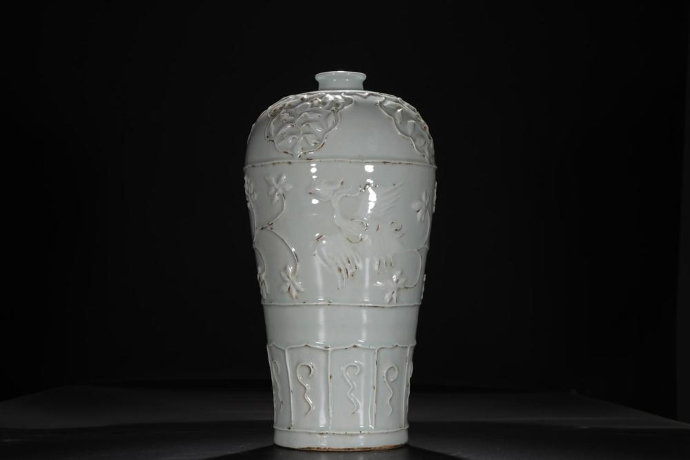 A CARVED WHITE-GLAZED MEIPING .MING PERIOD
