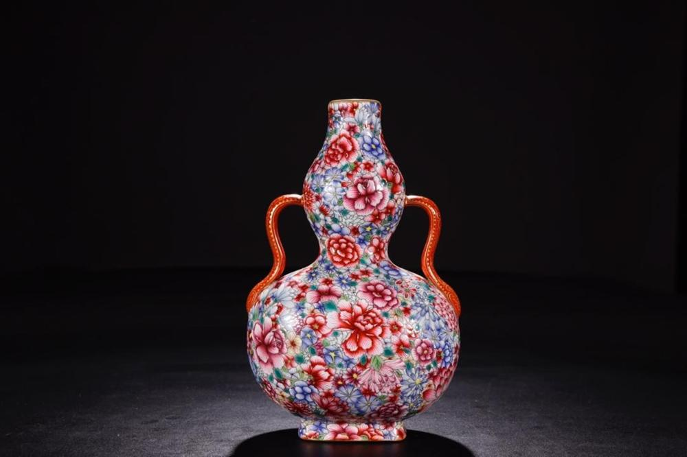 A FAMILLE-ROSE 'HUNDRED FLOWERS' DOUBLE-GOURD VASE.MARK OF QIANLONG