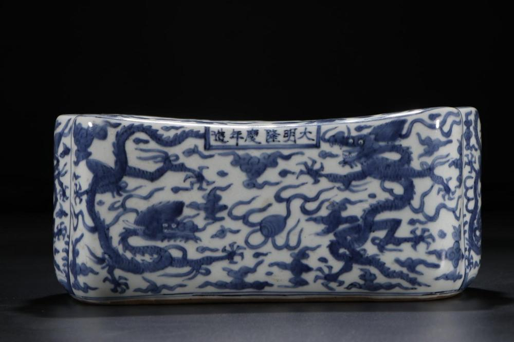 A BLUE AND WHITE 'DRAGON' PILLOW.MARK OF LONGQING