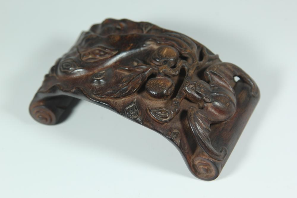 A CARVED AGALLOCH WOOD PENREST.ANTIQUE