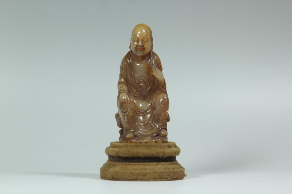 A SOAP STONE CARVING OF LUOHAN.ANTIQUE