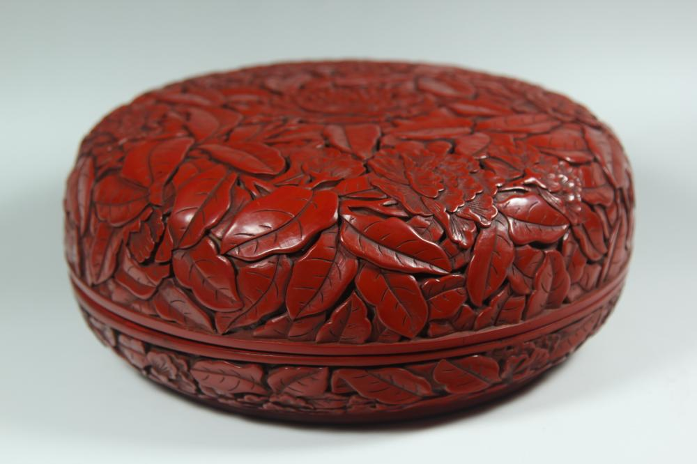 A CARVED CINNABAR RED LACQUER BOX AND COVER.ANTIQUE