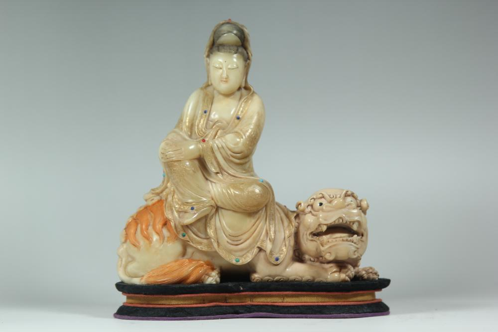 A SAOPSTONE CARVING OF GUANYIN.ANTIQUE