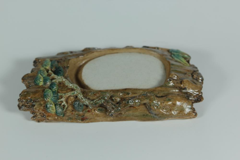 A PORCELAID PINE TREE WASHER.ANTIQUE