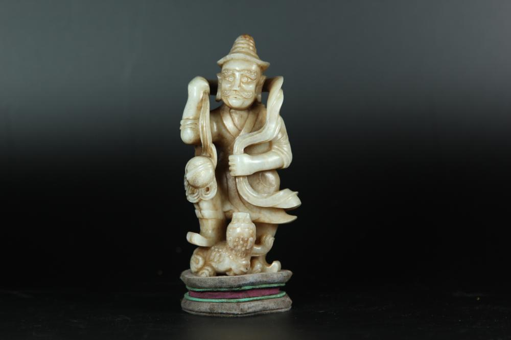 A CARVED WHITE JADE FOREIGNER. ANTIQUE
