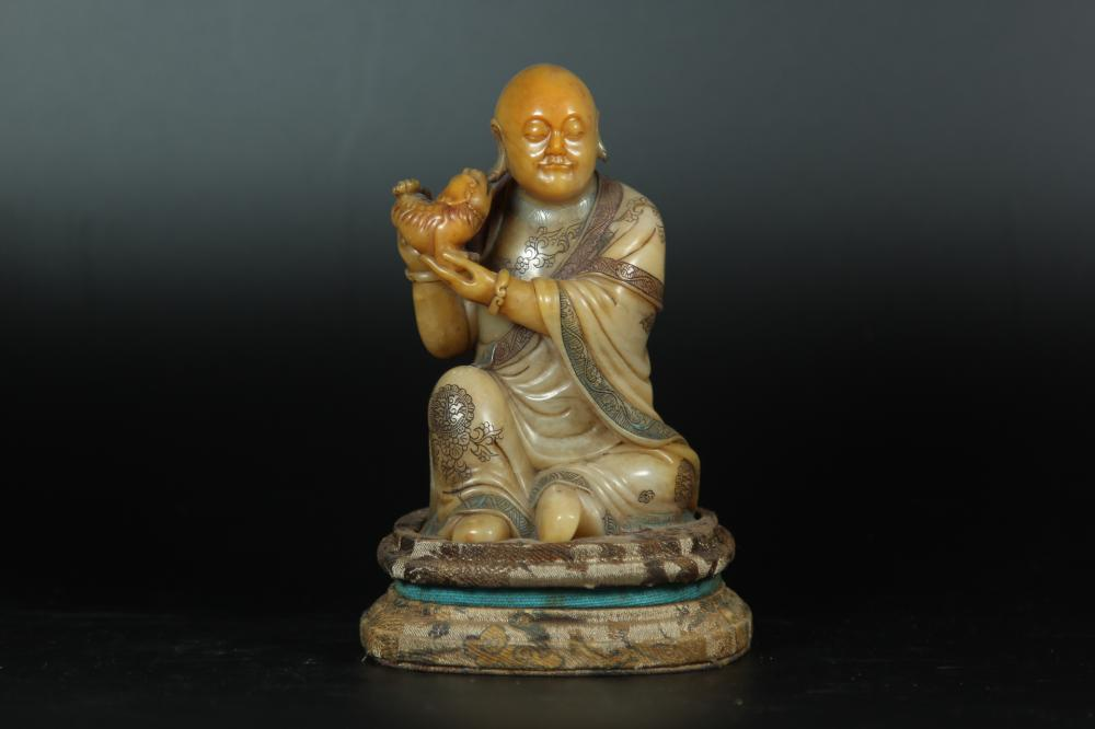 A CARVED SAOPSTONE LUOHAN.ANTIQUE