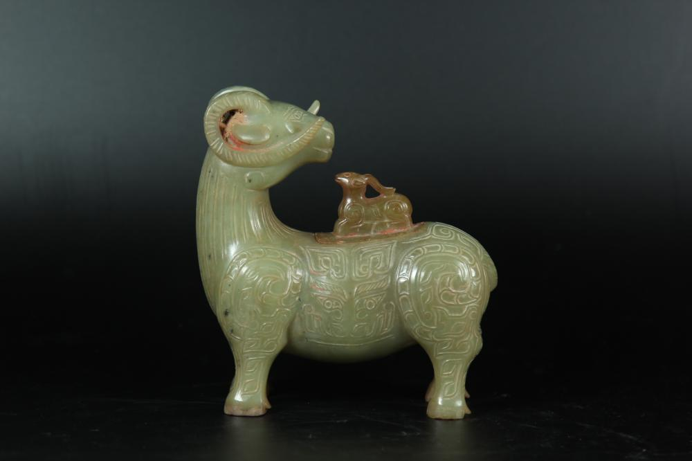 A CARVED YELLOW-JADE SHEEP.ANTIQUE