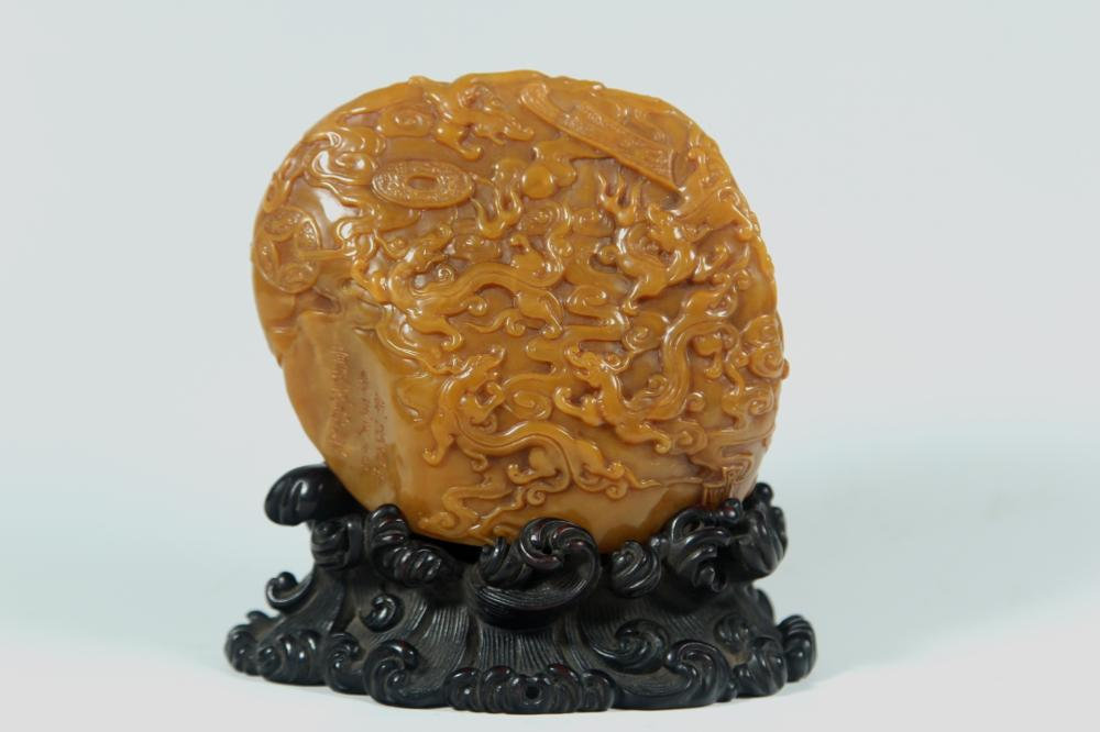 A CARVED TIANHUANG STONE 'DRAGON' MODEL.