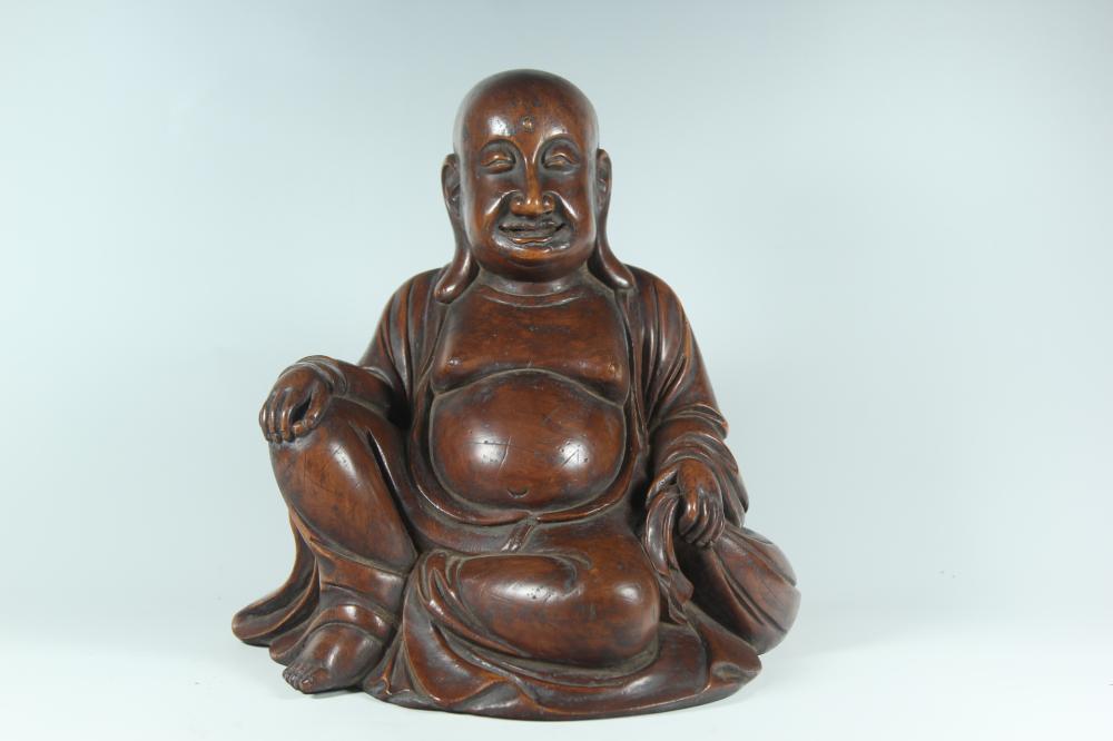 A CARVED HUANGYANGMU BUDDHA.ANTIQUE