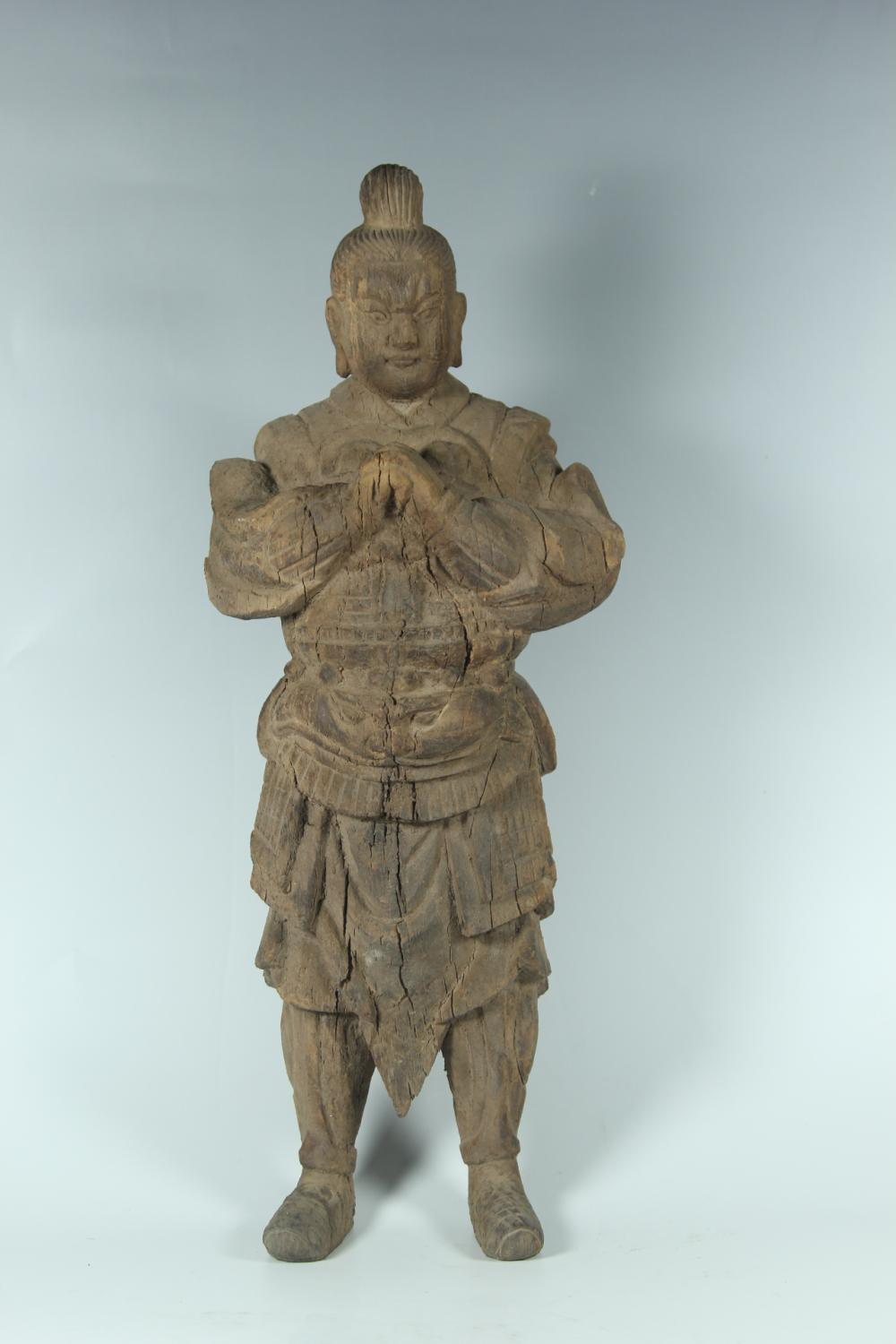 A CARVED WOOD GUARDIAN.ANTIQUE
