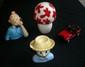 HERGE  Tintin  (Buste la chaise longue avec accidents, Tirelire champignon, Voiture Dupondt, Buste Tintin téléphone)