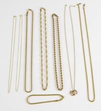 A group of gold jewellery, including rope, curb an