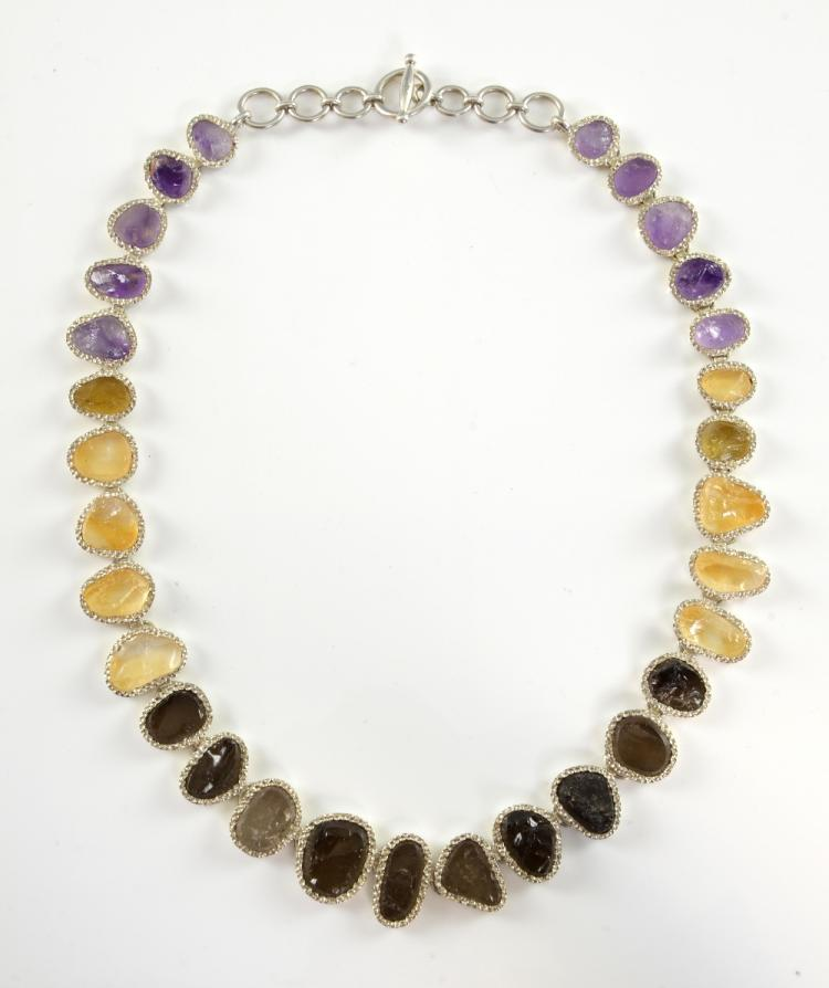 Silver fringe necklace made up of amethyst, citrin