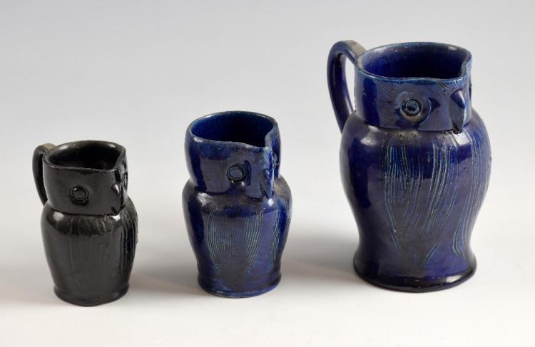 Farnham Pottery, Surrey, three owl jugs, 12cm, 9cm