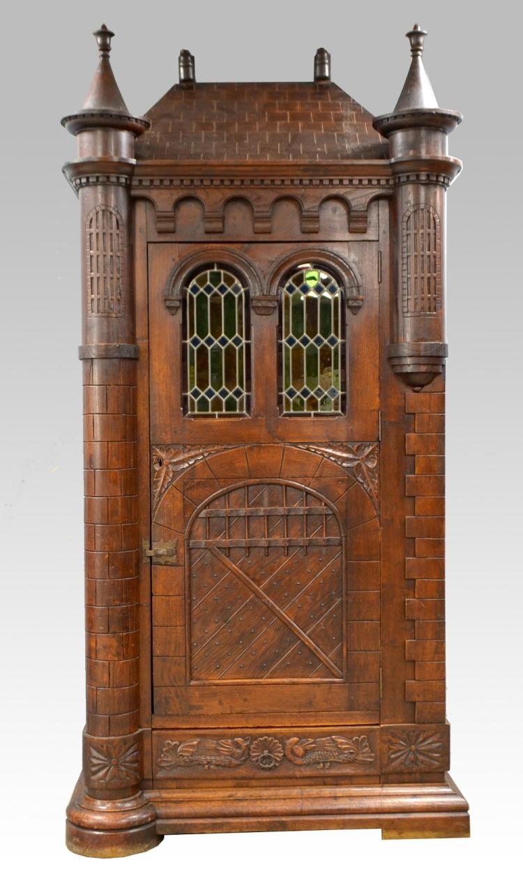 German oak single door cabinet with pitched top an