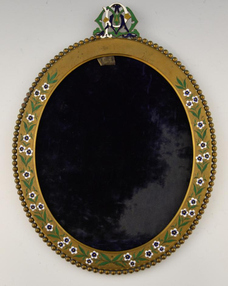 A gilt brass frame, incised and decorated with e