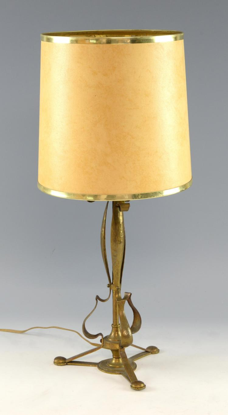 A brass table lamp with hammered finish 36cm.