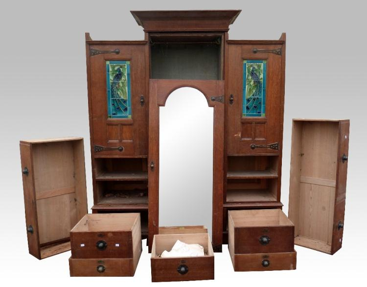 An Arts & Crafts oak compactum wardrobe, with cent
