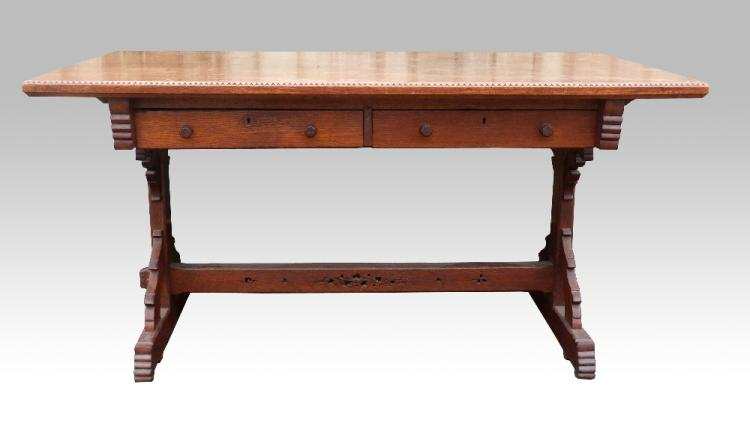 Gothic Revival oak table, the top with chip carved