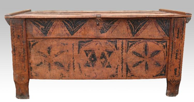 An oak plank top coffer with pen work star and flo