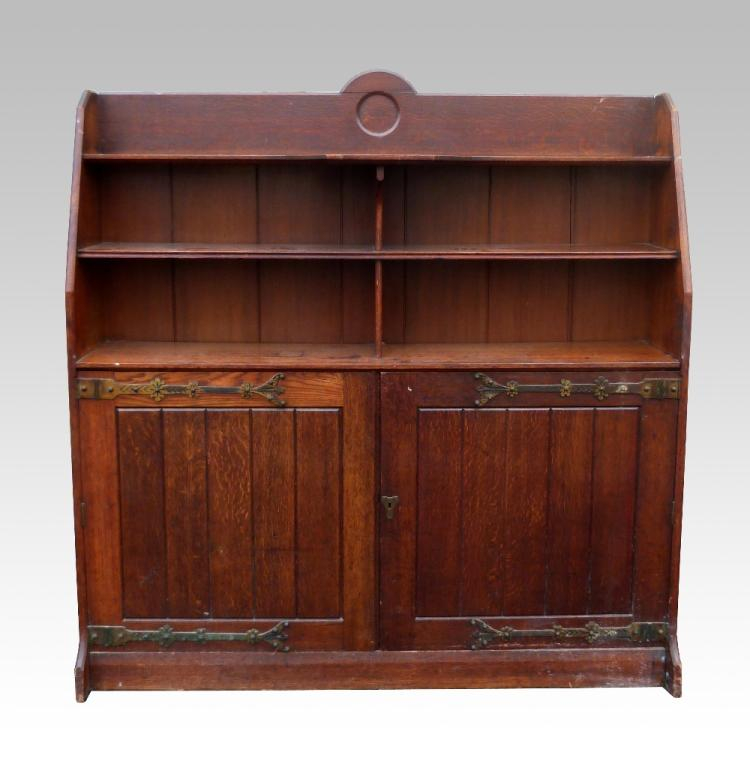 Late 19th C Oak bookcase cabinet, with brass stra