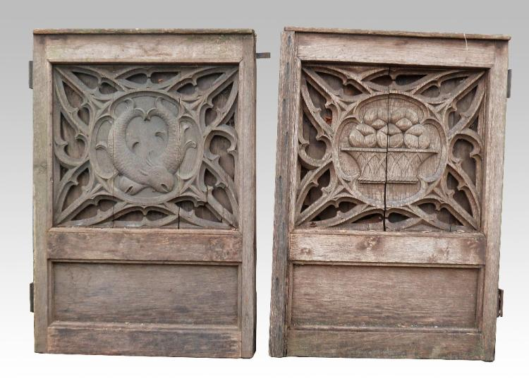 Two oak carved panels one depicting fish within a