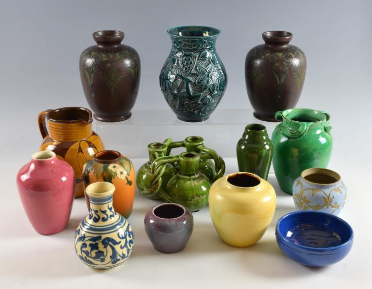 A Collection of fourteen Art pottery vases and bow