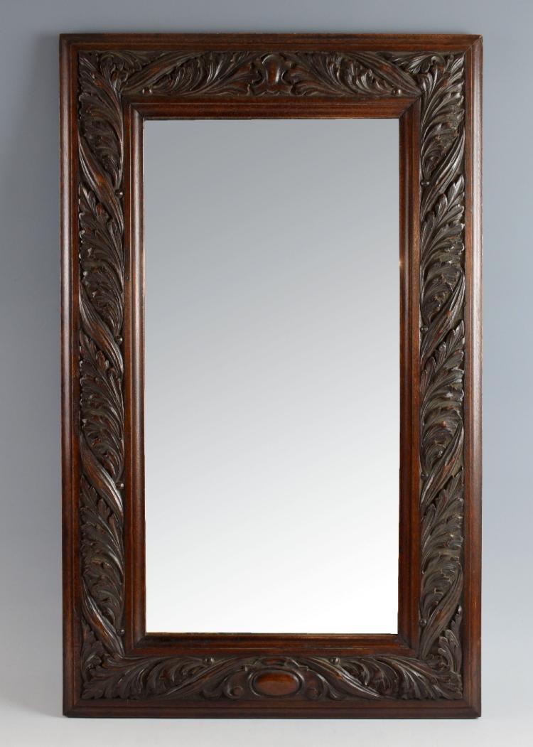 Arts & Crafts mahogany wall mirror, the frame heav