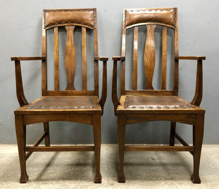 Set of ten oak dining chairs including two carvers