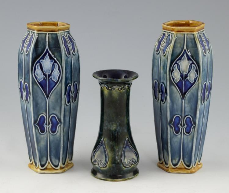 Doulton Lambeth, a pair of hexagonal form vases wi