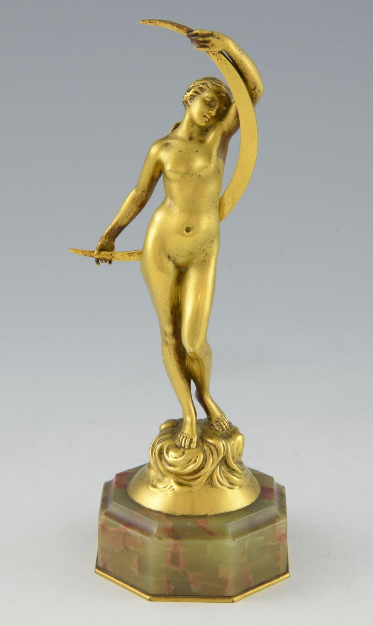 J. Dorval, bronze figure of a nude maiden holding