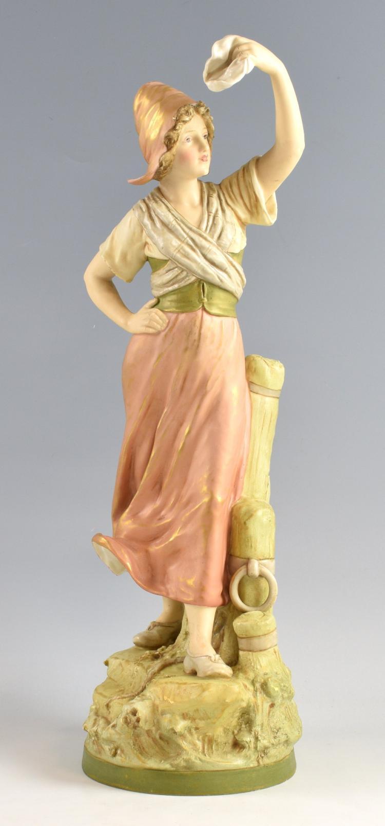 Royal Dux figure of a young woman waving a white h