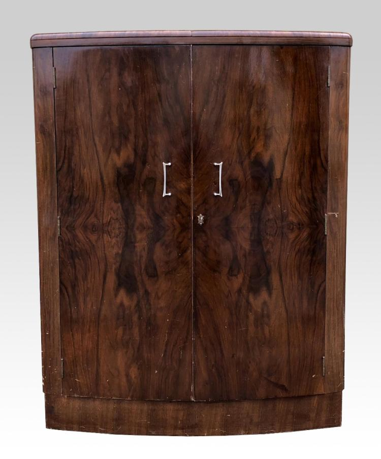 An Art Deco drinks cabinet with walnut veneer, and