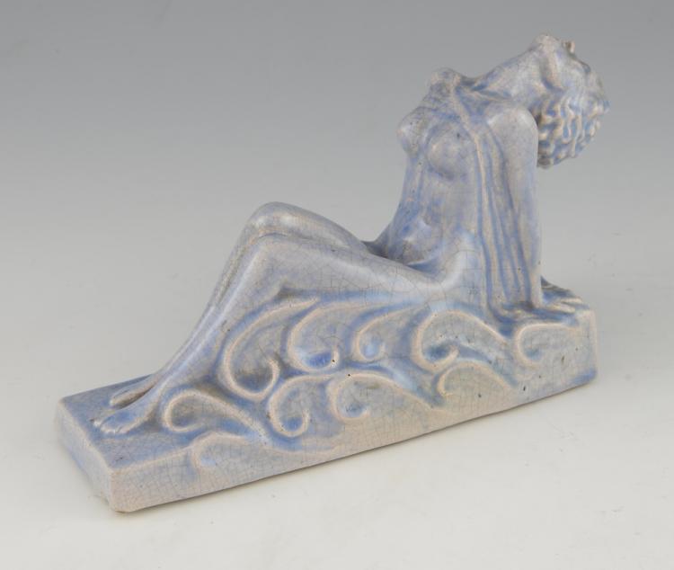 An Art Deco ceramic crackle glaze figure of a rec